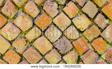Wall made of stone or brick in the archaeological ruins of the ancient Roman town Velia Campania. Italy
