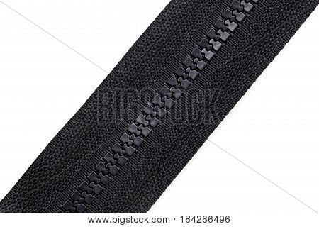 Black lock on clothes on white background .