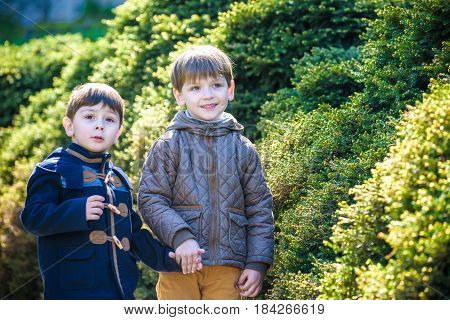 Portrait Of Two Boys, Siblings, Brothers And Best Friends Smiling. Friends Hugging. Happy Kids Weari