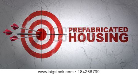 Success construction concept: arrows hitting the center of target, Red Prefabricated Housing on wall background, 3D rendering