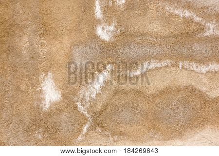 White salt on concrete wall as background .