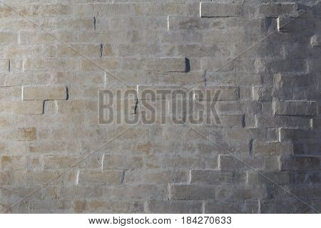 whitewash brick wall horizontal background with side sunlight