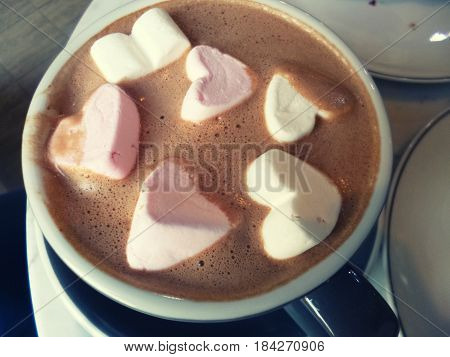 Cocoa with marshmallow. Hot chocolate with heart shaped marshmellow sweets. Romantic drink, hot beverage