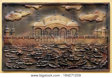 KOLKATA,INDIA - FEBRUARY 09, 2016: Jalmandir-Pavapuri Bihar - the place where Lord attains Nirvan, Street bas relief on the wall of Jain Temple (also called Parshwanath Temple) in Kolkata.