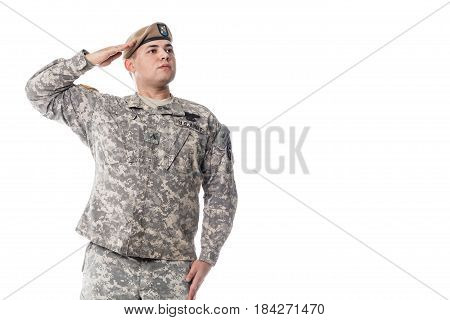 National Anthem is played. Army Ranger from Special Troops Battalion in universal Camouflage pattern Uniforms and Tan beret with Ranger Regiment crest is standing to attention and saluting proudly with honor and respect. Service to his country concept. Na poster