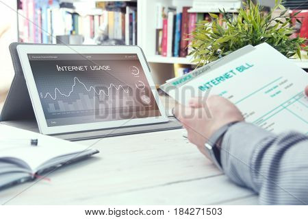 Tablet pc with internet usage application and man holds bill for internet. Internet usage application made in graphic program.