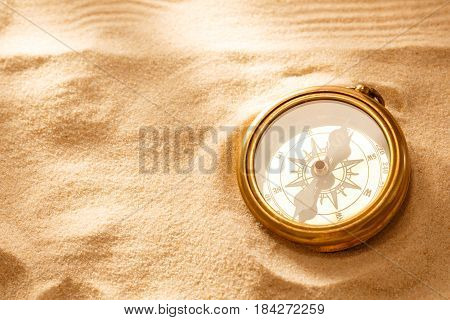 Golden Compass With Beach Sand
