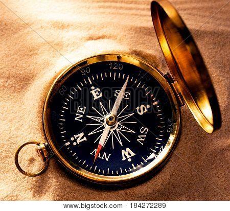 Golden Compass With Beach Sand