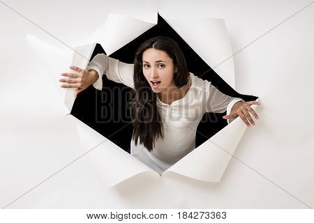 Woman Outside the hole in the white wall