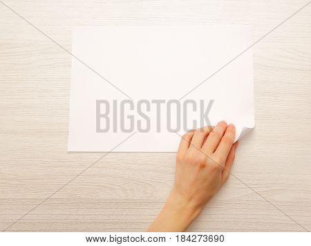 Woman's Hand Turning Over Paper