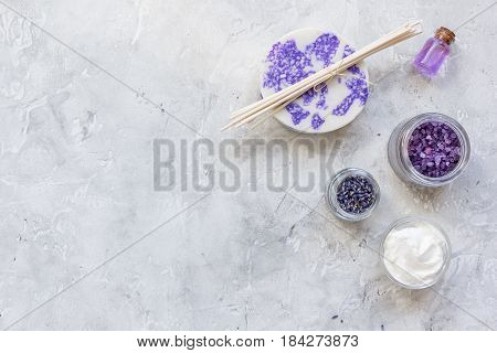 body cream with lavender herbs cosmetic set on stone table background top view mock-up