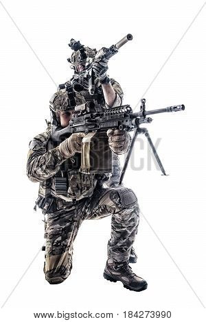 Two Army Rangers in field Uniforms with weapon. Studio shot