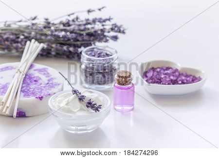 natural herb cosmetic with lavender flowers flatlay on white table background