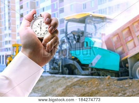 Asphalt-placing Machine And Stopwatch In Hand