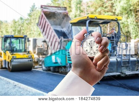 Road Roller Working And Stopwatch In Hand