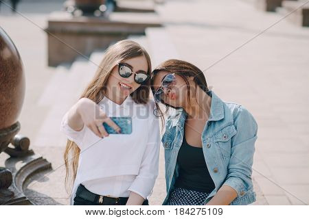Girls walking around the city and make selfie