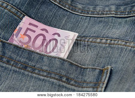 Five hundred Euro banknote in the pocket of blue Jean