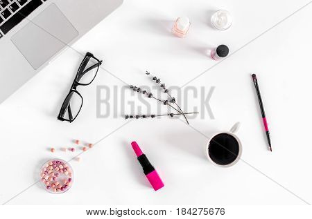 make up set with decorative cosmetics for beauty design on work woman desk background top view