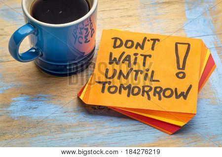 Do not wait until tomorrow - advice or reminder on a sticky note with a cup of coffee