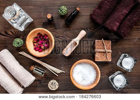 Aromatherapy SPA set with salt and natural oil on wooden desk background top view