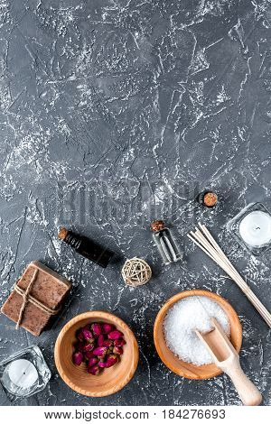 spa composition for body care with sea salt on dark background top view mock up