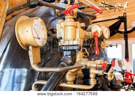 Samara Russia - April 29 2017: Retro steam locomotive boiler with engineering equipment. Furnace department of the retro train driver