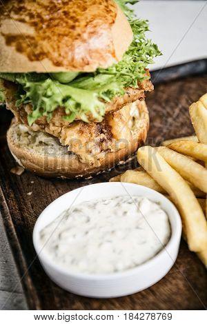fish fillet burger with fries and tartar sauce set snack meal