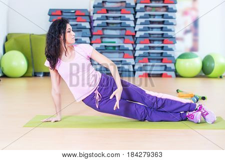 Fit woman doing plank core exercise training back and press muscles