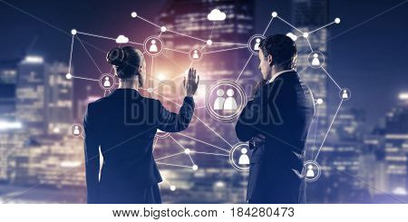 Businessman and businesswoman standing with back and touching connection concept