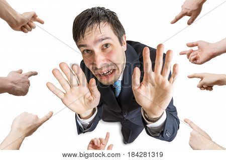 Many Hands Are Pointing And Blame Stressed Man. Isolated On Whit