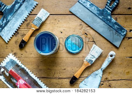 building implements set for house repair on wooden desk background top view