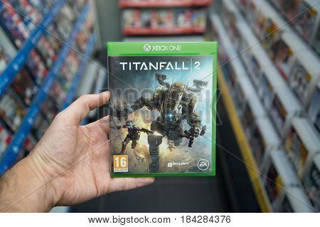 Bratislava, Slovakia, circa april 2017: Man holding Titanfall 2 videogame on Microsoft XBOX One console in store