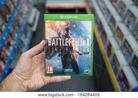 Bratislava, Slovakia, circa april 2017: Man holding Battlefield 1 videogame on Microsoft XBOX One console in store