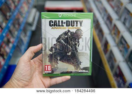 Bratislava, Slovakia, circa april 2017: Man holding Call of Duty Advanced Warfare videogame on Microsoft XBOX One console in store