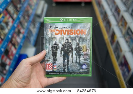 Bratislava, Slovakia, circa april 2017: Man holding Tom Clancy's The Division videogame on Microsoft XBOX One console in store