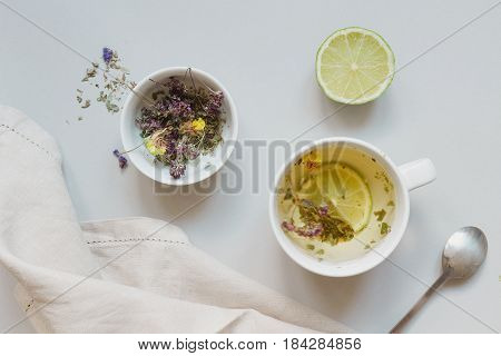 Tea Time. Cup Of Hot Herbal Tea And Dry Tea On The Gray Background, Top View