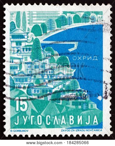 YUGOSLAVIA - CIRCA 1959: a stamp printed in Yugoslavia shows Ohrid Macedonia Tourist Attractions circa 1959