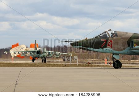 KUBINKA, MOSCOW REGION, RUSSIA - APRIL 24, 2017: Sukhoi Su-25BM attack airplanes of Russian air force during Victory Day parade rehearsal at Kubinka air force base.