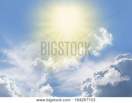 Miraculous Heavenly Light -  Blue sky, fluffy clouds and a beautiful bright yellow radiating star shaped light depicting a holy entity