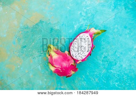 Pitahaya on a turquoise background. Exotic fruits. Copyspace