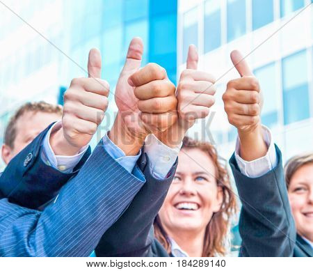 group of business with the thumb up