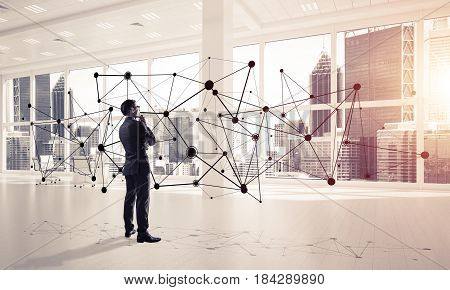 Elegant businessman in modern office interior and social connection concept. Mixed media