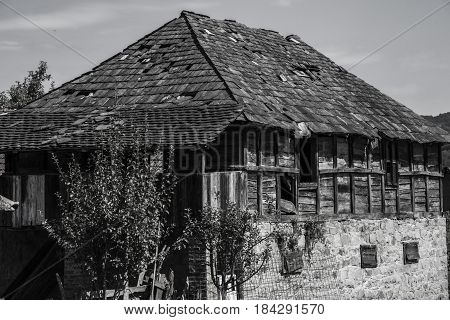 my old house, house in black and white, antique house, house made of wood and stone, historic house,  countryside house, very old house photography in black and white color