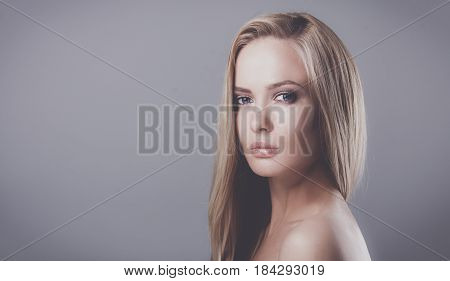 Portrait of a beautiful woman , isolated on grey background