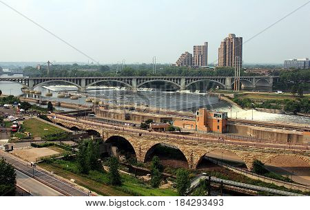 Minneapolis, Minnesota. View on Mississippi River, I-35 and Stone Arch Bridges.