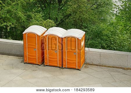 Row of mobile toilets in an urban area