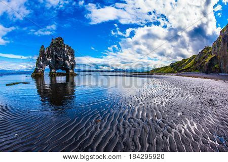 North Coast Iceland. The concept of extreme northern tourism. The famous Hvitserkur - basalt rock in the form of a huge mammoth