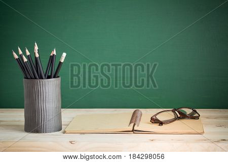Books and pencil on wooden table,Back to school supplies,education of concept