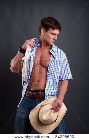 The private cowboy is holding a cowboy hat.