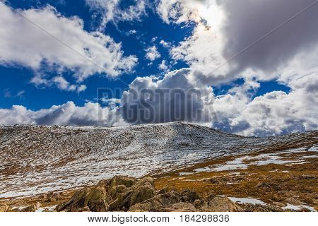 Beautiful Landscape Of Snow-covered Mountains And Fluffy Clouds In Australia